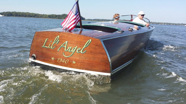 gold leaf lettering on wooden boat